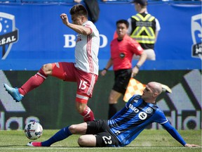 Montreal Impact's Laurent Ciman, right, challenges Atlanta United's Hector Villalba during first-half MLS soccer game action in Montreal, Saturday, April 15, 2017.
