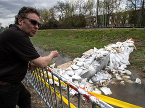 Now that a small dike was constructed between a city bike path and the AMT train tracks, the area around 5th Ave. N. and Gouin Blvd. is completely dry in Pierrefonds-Roxboro, on Friday, May 12, 2017. Jeff Arsenault is one of the owners whose home was under water due to the decision by the AMT to not allow anyone on their land. Once the dam was built the streets were drained in three hours.