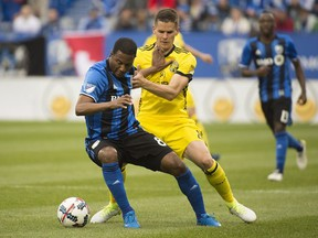 Impact's Patrice Bernier, left, holds off a challenge by Columbus Crew's Jukka Raitala during second half MLS soccer action in Montreal on Saturday, May 13, 2017.