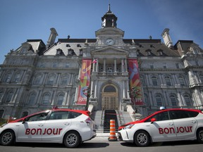 Taxis wait outside Montreal city hall.
