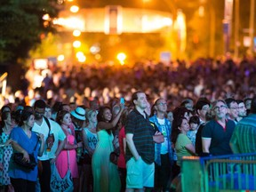 A crowd watches a performance at the Montreal International Jazz festival on Friday, July 5, 2013.