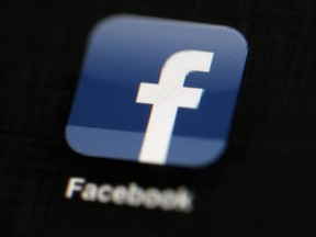 FILE - In this May 16, 2012, file photo, the Facebook logo is displayed on an iPad in Philadelphia. Facebook reports financial results Wednesday, Nov. 2, 2016.