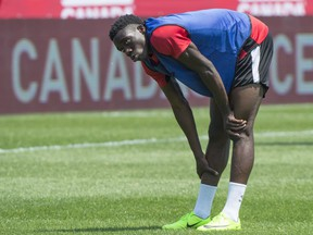 Canada's Alphonso Davies, 16, stretches during a team practice on Monday, June 12, 2017 in Montreal.