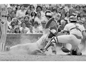 Montreal Expos' Tim Raines steals home in Chicago on May 23, 1981. Raines swiped 70 or more each year from 1981-86, among the 808 he accumulated over 23 major league seasons.