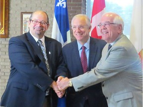 Jacques-Cartier MNA Geoffrey Kelley (left to right), Lac-Saint-Louis MP Francis Scarpaleggia and Beaconsfield Mayor Georges Bourelle following a joint funding announcement to improve the aqueducts and sewers in the city. (Photo courtesy City of Beaconsfield)