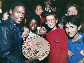 Montreal Expos' Tim Raines shows off a birthday cake, on Sept. 16, 1980, given to him by students at West Hill High School in N.D.G. for his 27th birthday.
