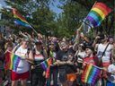The streets were packed with onlookers dressed to enjoy the day as they watched the Pride parade along Boulevard René-Lévesque  in Montreal, on Sunday, August 20, 2017.