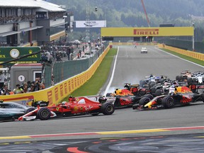 Mercedes driver Lewis Hamilton of Britain, left, leads Ferrari driver Kimi Raikkonen of Finland, second left, into the first corner during the start of the Belgian Formula One Grand Prix in Spa-Francorchamps, Belgium, Sunday, Aug. 27, 2017.