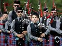 A younger piper with the Glengarry Pipe Band takes part in the Montreal Highland Games in Montreal on Sunday August 6, 2017.