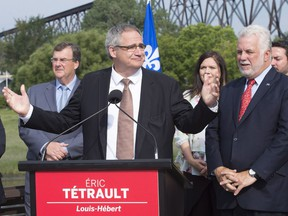 Eric Tetrault, left, candidate for a by-election in the Louis-Hébert riding, speaks at a press conference with Quebec Premier Philippe Couillard Aug. 15, 2017.