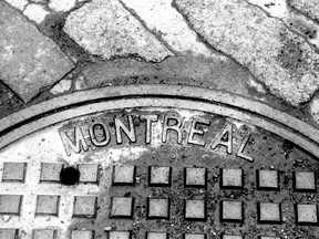 A manhole cover in Old Montreal, 1997.