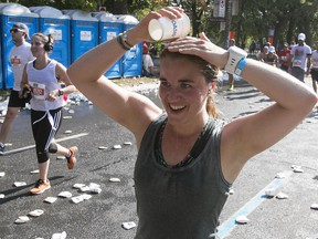 Camille Perreault tries to cool down while taking part in the half-marathon on Sunday, Sept. 24, 2017. The full 42.2-kilometre event was cancelled becauase of concerns about the heat wave.