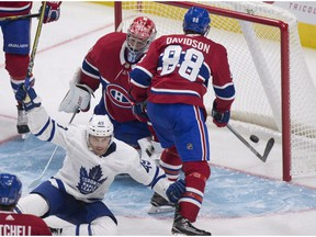 Toronto Maple Leafs' Andreas Johnsson, bottom left, celebrates scoring against Montreal Canadiens goalie Carey Price while Brandon Davidson looks inside the net, during third period NHL pre-season action Wednesday, September 27, 2017, in Quebec City.