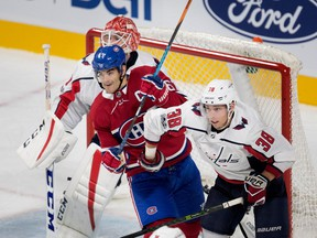 Washington Capitals Colby Williams crowds Montreal Canadiens' Max Pacioretty in front of goalie Pheonix Copley during preseason NHL play at the Bell Centre in Montreal on Wednesday September 20, 2017.