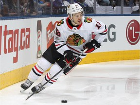 Chicago's rookie right-winger Alex DeBrincat scored his first NHL goal, added an assist and was named the second star in a 3-1 Blackhawks win over the Canadiens Tuesday night.