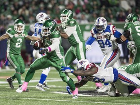 Saskatchewan Roughriders running back Trent Richardson (33) breaks a tackle as he runs the ball down field during second half CFL football action against the Montreal Alouettes in Regina on Friday, October 27, 2017. THE CANADIAN PRESS/Rick Elvin ORG XMIT: RE118 Rick Elvin,