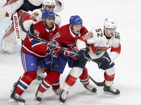 Canadiens' Tomas Plekanec and Brendan Gallagher, 11, are flanked by Panthers Ian McCoshen, left rear, and Mackenzie Weegar during an October game at the Bell Centre.