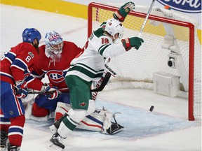 Wild's Jason Zucker beats Canadiens goalie Charlie Lindgren for one of his three third-period goals Thursday night at the Bell Centre.