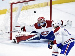 Montreal Canadiens' Jeff Petry watches a goal by Minnesota Wild left wing Tyler Ennis get past Canadiens goalie Carey Price during the first period Nov. 2, 2017, in St. Paul, Minn.