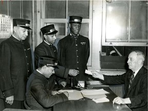 Porters Winslow (no other name available); Jean Napoleon Maurice, Sam Morgan and (seated) James Thompson get their assignments from W.A. Gough, sleeping agent at Windsor station in Montreal in August 1944. Until the 1950s, most black men in Montreal worked for the railway companies as sleeping car porters, red caps and some categories of dining car employees, historian Steven High writes.