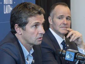 Newly appointed Impact head coach Rémi Garde responds to questions as team president Joey Saputo listens during a news conference in Montreal on Wednesday, November 8, 2017.