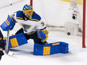 The puck flies into the net past St. Louis Blues goalie Jake Allen on a goal by Montreal Canadiens' Shea Weber, not seen, during second period NHL hockey action in Montreal on Tuesday, December 5, 2017.