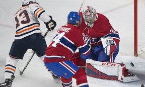 Edmonton Oilers' Michael Cammalleri (13) scores against Canadiens goaltender Carey Price as Canadiens' Tomas Plekanec defends during first period NHL hockey action in Montreal, Saturday, Dec. 9, 2017.