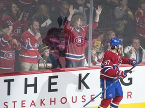 Canadiens captain Max Pacioretty celebrates along with fans after scoring on Boston Bruins goaltender Tuukka Rask during NHL game at the Bell Centre in Montreal on Jan. 20, 2018.