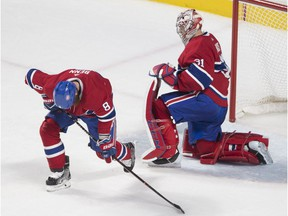 Montreal Canadiens goaltender Carey Price and Jordie Benn react after a goal by Boston Bruins David Pastrnak during third period at the Bell Centre, in Montreal on Jan. 20, 2018.
