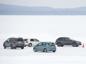 Four cars participate in a winter ice driving lesson on the Lake of Two Mountains.