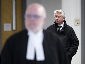 Jimmy Accurso, son of Antoino Accurso, walks behind lawyer Marc Labelle as he leaves the Joliette courthouse after testifying in his father's trial Jan. 26, 2018.