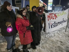 People attend a vigil against Islamophobia, on the corner of Henri-Bourassa and Lacordaire on Monday January 29, 2018. The vigil was to mark the one-year anniversary of the Quebec City mosque shooting.