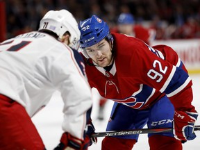 Canadiens centre Jonathan Drouin, right, has scored only five goals and is winning only 39.9 per cent of his faceoffs this season.