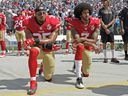 San Francisco 49ers' Colin Kaepernick (right) and Eric Reid kneel during the national anthem before a NFL football game against the Carolina Panthers in Charlotte, N.C., on Sept. 18, 2016.
