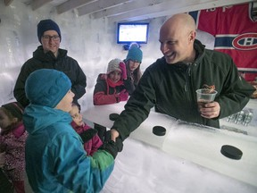 Derek Parker greets young fans during his Habs game party in his backyard ice palace/bar in Brossard on Thursday, Feb. 1, 2018.