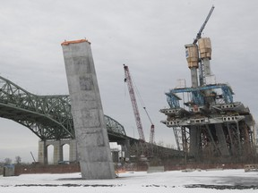 Part of the main pylon of the cable-stayed section of the new Champlain bridge, right, and the legs on the south shore of the work site on Friday February 23, 2018.