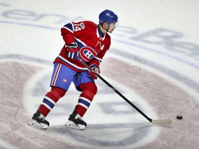 Tomas Plekanec skates past centre ice during warmup before game between the Canadiens and Florida Panthers at the Bell Centre in Montreal on Oct. 24, 2017.