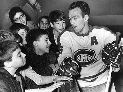Montreal Canadiens' Henri Richard, greeting children at the Forum back in the day.