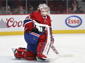 Canadiens goalie Carey Price takes break during stoppage of play during game against the New York Islanders at the Bell Centre in Montreal on Jan. 15, 2018.