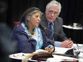 Mohawk community member Sedalia Kawennotas and commissioner Jacques Viens at the Viens Commission, a public inquiry into the mistreatment of Indigenous people in Quebec in 2018.