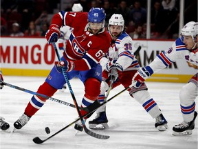 Max Pacioretty is crowded by New York Rangers players on Feb. 22. Pacioretty has been the subject of ridiculous conspiracy theories that don't hold up, writes Jack Todd.