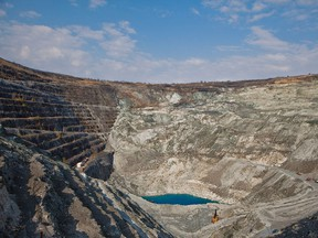 A small lake is seen at the bottom of the 2.5 kilometre-wide asbestos mining pit at Mine Jeffrey Inc. located in the town of Asbestos, Quebec.
