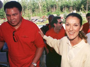 Muhammad Ali and Celine Dion, with Yank Barry in the background. Photo was taken during Ali's visit to Dion's golf course in Terrebonne on Aug. 17, 1997.