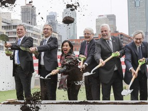 Jean-Marc Arbaud, Henri Poupart-Lafarge, Valerie Plante, Marc Garneau, Philippe Couillard and Michael Sabia at sod-turning ceremony in Griffintown to inaugurate the REM on Thursday April 12, 2018.