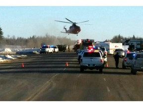 This image provided by 650 CKOM/980 CJME shows emergency crews responding to the scene where a bus carrying a junior hockey team to a playoff game was struck by a semi Friday, April 6, 2018, north of Tisdale, Saskatchewan,