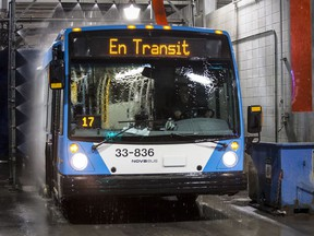 A bus gets washed at the STM Stinson Transport Centre on Friday March 18, 2016, in Montreal.