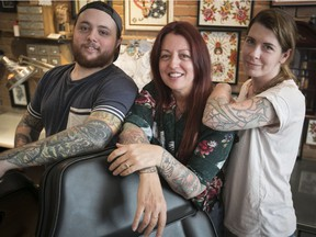 """""""The level of tattooing in Montreal, and around the world, has exploded. They're artists, for real,"""" says Tattoo Nouvelle Ère organizer Geneviève Mecteau, right, with co-organizer William Q. Gauthier and convention founder Pascale Quesnel at the MTL Tattoo shop."""