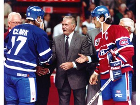 Maurice (Rocket) Richard dropped the puck for the ceremonial faceoff between Canadiens captain Guy Carbonneau and his Maple Leafs counterpart, Wendel Clark, at the Montreal Forum on Oct. 4, 1991. The Leafs were more popular than the Habs in a Canada-wide poll in 1993.