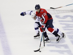 Brayden Point of the Tampa Bay Lightning skates against Lars Eller, right, of the Washington Capitals in the first period of Game 6 of the Eastern Conference finals during the 2018 NHL Stanley Cup Playoffs at Capital One Arena on May 21, 2018, in Washington.