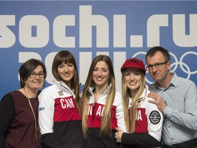 Skier sisters Maxime, left, Chloe and Justine Dufour-Lapointe, with their parents Johane Dufour, and Yves Lapointe at the Sochi Winter Olympics in Sochi on Sunday, February 9, 2014.